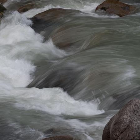 River flowing through rocks, Whistler, British Columbia, Canada photo