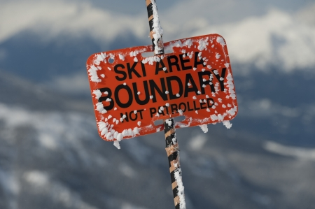 Close-up of a ski area boundary sign, Whistler, British Columbia, Canada photo