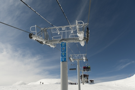 whistler: Low angle view of skiers on ski lifts, Symphony Amphitheatre, Whistler, British Columbia, Canada Stock Photo