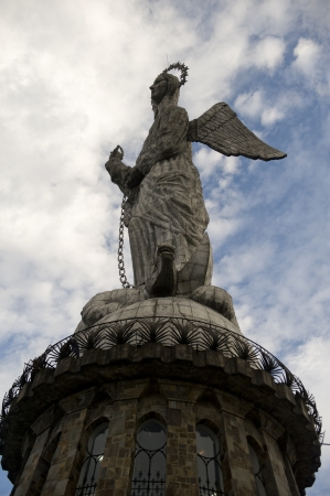 Low angle view of the statue of winged Virgin Mary of Quito, El Panecillo Hill, Quito, Ecuador photo