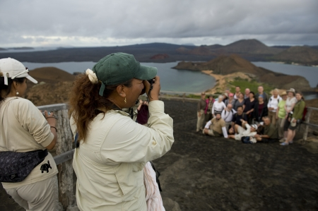 bartolome: Female tourists taking picture of their friends from an extinct volcanic mountain, Bartolome island, Galapagos Islands, Ecuador