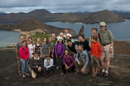 Group of tourists posing for a camera, Bartolome island, Galapagos Islands, Ecuador