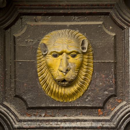 wood carving door: Lions face carved on a door, Cuzco, Peru