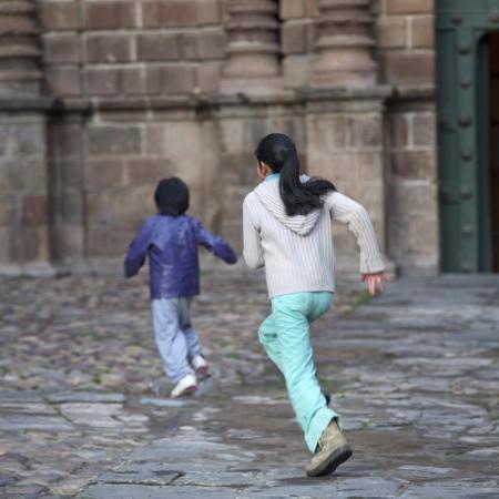Two children playing, Plaza de Armas, Cuzco, Peru Stock Photo - 16793129