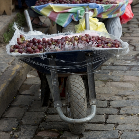 Plum for sale at a market stall on a wheelbarrow, Mercado Central, Cuzco, Peru Stock Photo - 16806263