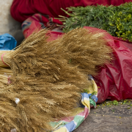 cusco region: Vendor selling stalks of wheat at a market stall, Sacred Valley, Cusco Region, Peru Stock Photo
