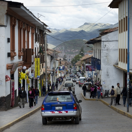 Cars and people on a narrow street, Sacred Valley, Cusco Region, Peru