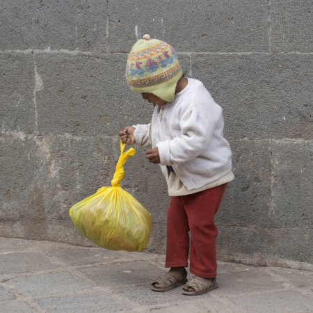 Boy playing with a plastic bag, Sacred Valley, Cusco Region, Peru