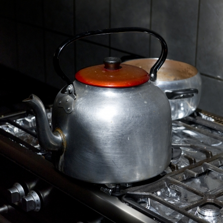 willka tika guesthouse: Kettle on a gas stove burner in a kitchen of a guesthouse, Willka Tika, Sacred Valley, Cusco Region, Peru