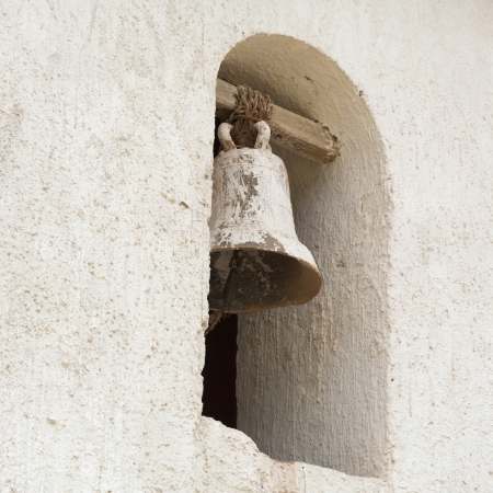 house of prayer: Bell hanging in a church, Maras, Sacred Valley, Cusco Region, Peru Stock Photo