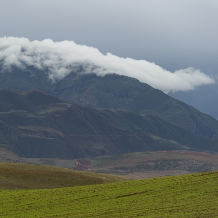 placidness: Clouds over mountains, Sacred Valley, Cusco Region, Peru Stock Photo