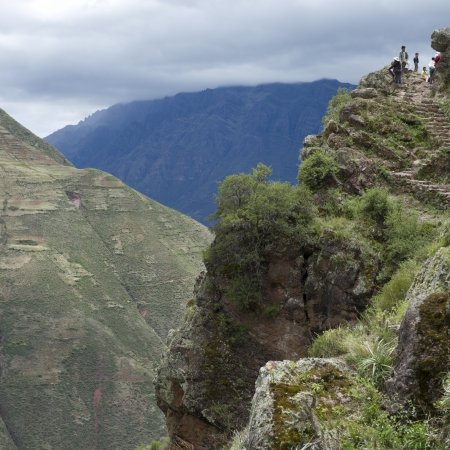 placidness: Tourists standing on a cliff, Pisac, Sacred Valley, Cusco Region, Peru