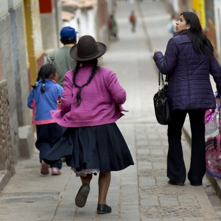 People walking in a street, Pisac, Sacred Valley, Cusco Region, Peru