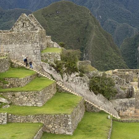 nature photography: Tourists at The Lost City of The Incas, Machu Picchu, Cusco Region, Peru Stock Photo