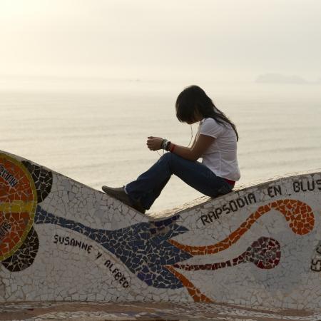 lima province: Woman listening to MP3 player in a park, El Parque Del Amor, Av De La Aviacion, Miraflores District, Lima Province, Peru