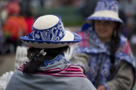 Quechua women wearing hats, Plaza Regocijo, Cuzco, Peru