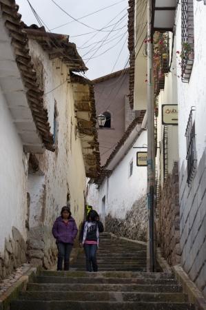 moving down: Female friend moving down a stepped walkway in Cuzco, Peru