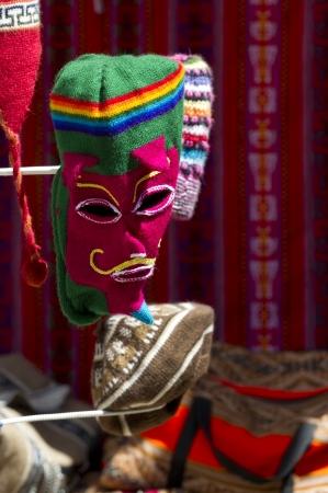 cusco province: Andean dance mask at a craft market in Barrio De San Blas, Cuzco, Peru