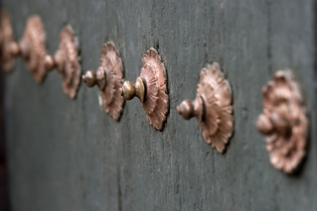 rivets: Close-up of rivets on a door in Cuzco, Peru Stock Photo