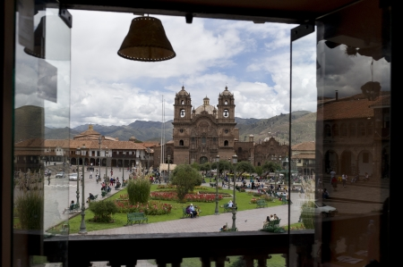 cuzco: Church viewed through a balcony, Iglesia de la Compania de Jesus, Plaza de Armas, Cuzco, Peru