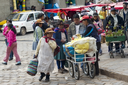 cusco region: People shopping in a market, Sacred Valley, Cusco Region, Peru Editorial