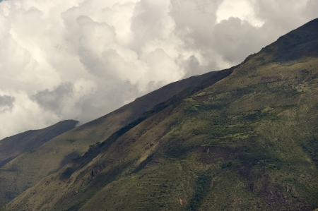 sacred valley of the incas: Clouds over a mountain range, Sacred Valley, Cusco Region, Peru Stock Photo