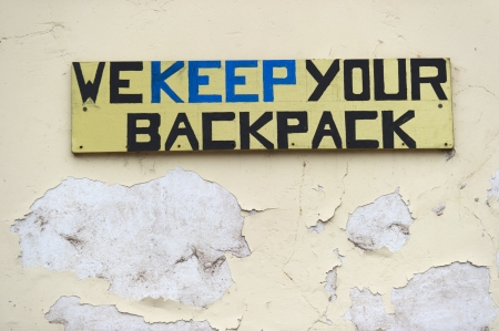 WE KEEP YOUR BACKPACK signboard at a store, Pisac, Sacred Valley, Cusco Region, Peru