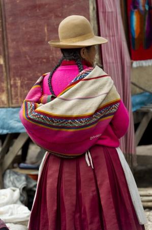Woman shopping in a market, Pisac, Sacred Valley, Cusco Region, Peru