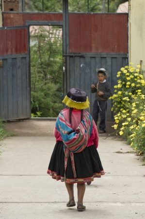 Girl in the schoolyard of Chumpepoke Primary School, Sacred Valley, Cusco Region, Peru