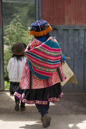 Girls in the schoolyard of Chumpepoke Primary School, Sacred Valley, Cusco Region, Peru photo