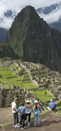 Tourists at The Lost City of The Incas, Machu Picchu, Cusco Region, Peru photo