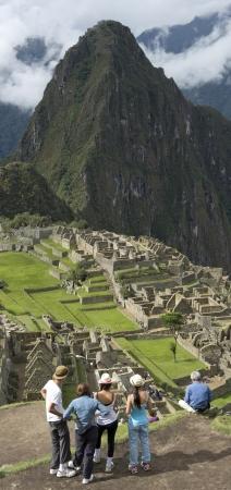 placidness: Tourists at The Lost City of The Incas, Machu Picchu, Cusco Region, Peru Stock Photo