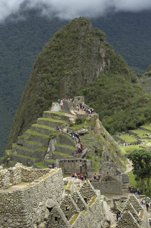 tranquilly: Tourists at The Lost City of The Incas, Machu Picchu, Cusco Region, Peru Stock Photo