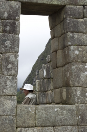 sacred valley of the incas: Tourist at The Lost City of The Incas, Machu Picchu, Cusco Region, Peru