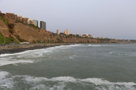 lima province: Waves with a city in the background, Miraflores District, Lima Province, Peru