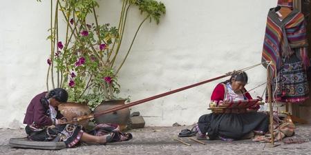 Women sitting in front of an art museum, Museo De Arte Precolombino, Cuzco, Peru