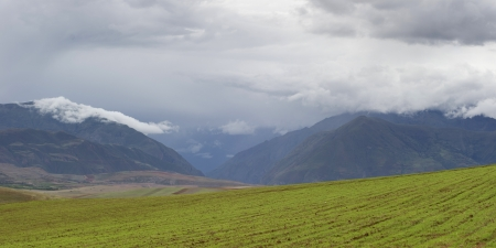 placidness: Clouds over an agricultural field, Sacred Valley, Cusco Region, Peru