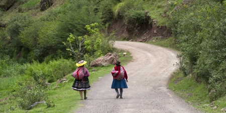 tranquilly: Women walking on a dirt road, Sacred Valley, Cusco Region, Peru