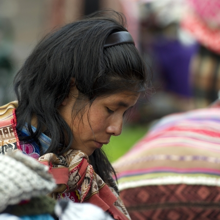 Profile of a Quechua woman thinking, Plaza Regocijo, Cuzco, Peru