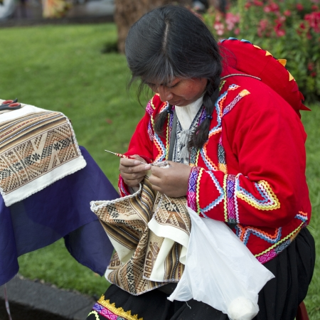 Quechua woman doing embroidery on a fabric, Plaza Regocijo, Cuzco, Peru