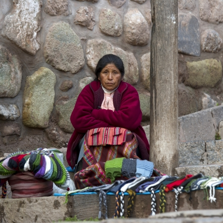 consumerist: Female street vendor selling traditional cloths, Cuzco, Peru