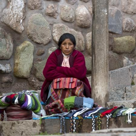 qusqu: Female street vendor selling traditional cloths, Cuzco, Peru