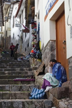 Street vendors along a stepped walkway, Cuzco, Peru