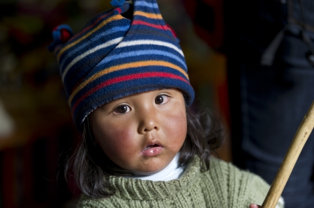 Portrait of a girl wearing a knit hat, Barrio de San Blas, Cuzco, Peru Stock Photo - 17227742