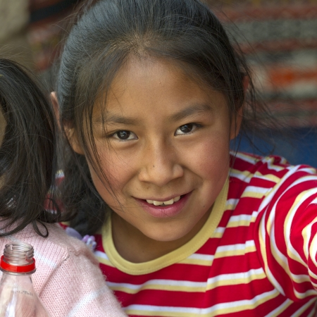 Portrait of a girl smiling, Barrio de San Blas, Cuzco, Peru