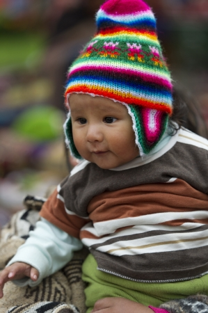 curiousness: Close-up of a baby wearing a knit hat, Plaza Regocijo, Cuzco, Peru Editorial
