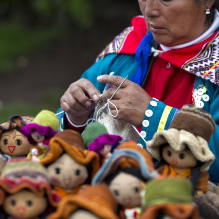 female likeness: Woman selling dolls at a market, Plaza Regocijo, Cuzco, Peru