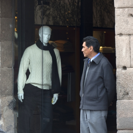 Man looking at the mannequin in the display window of clothing store, Cuzco, Peru