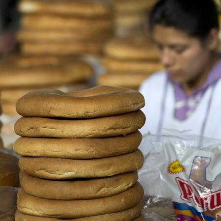 mercado central: Woman selling bread at Mercado Central, Cuzco, Peru
