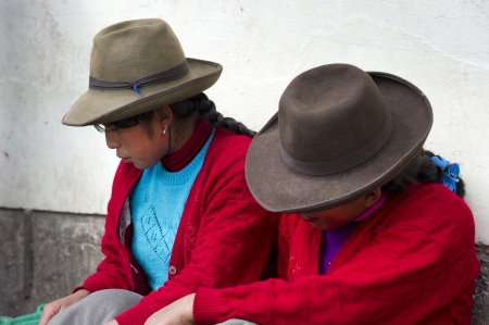 cuzco: Close-up of two women sitting together, Mercado Central, Cuzco, Peru Editorial